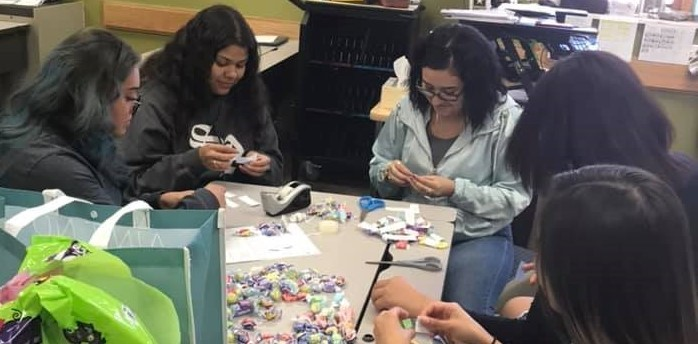 Students adding SOAR to candy