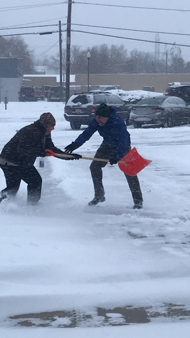 Mr. Legge and Mr. Ladow both wanting to shovel to keep our students safe!