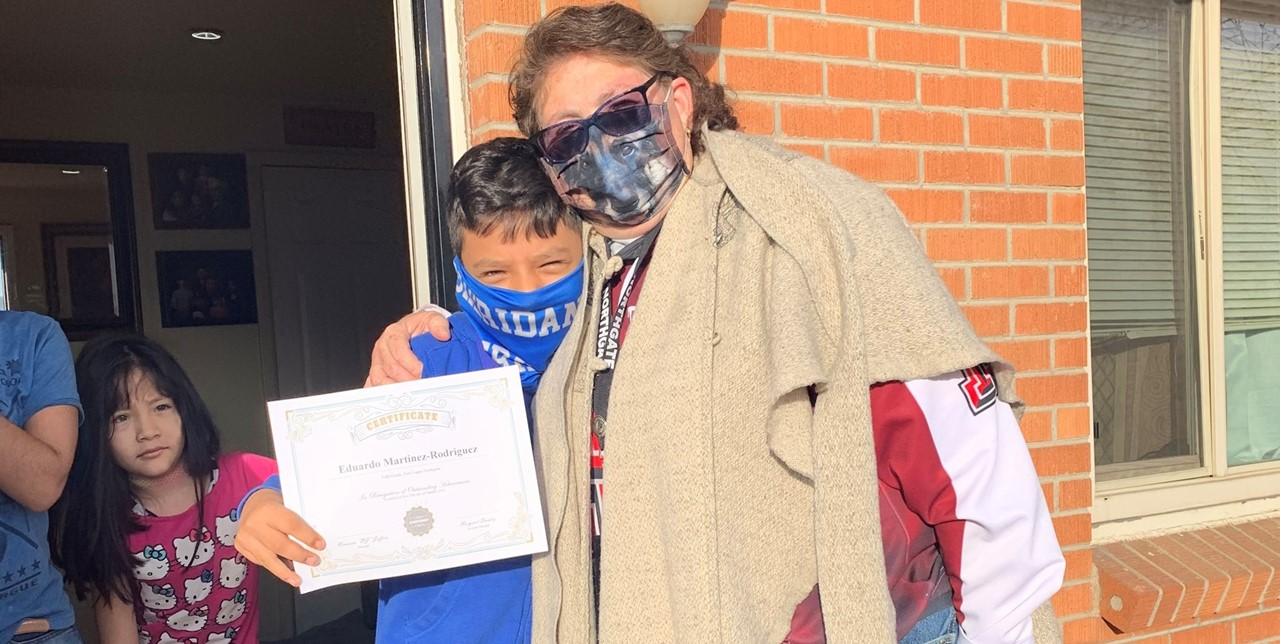 Principal BJ with 5th grade student of the month