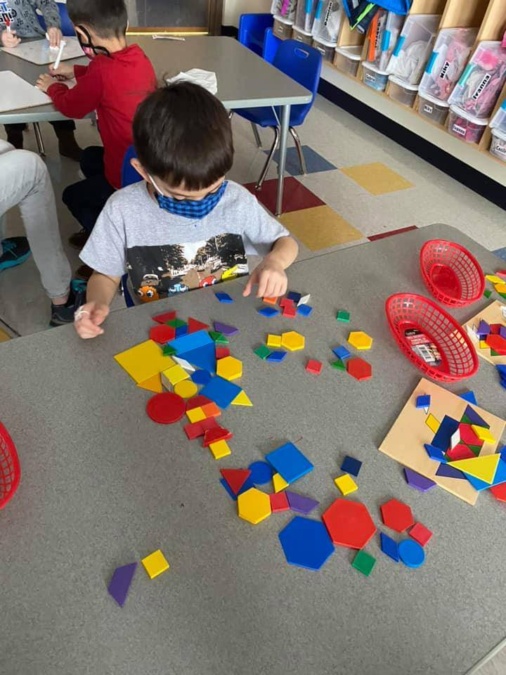 A student is sorting through different shapes