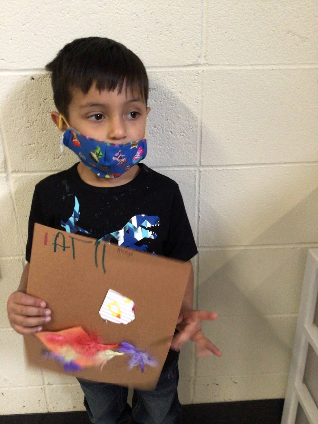 A student displays his turtle nest he made