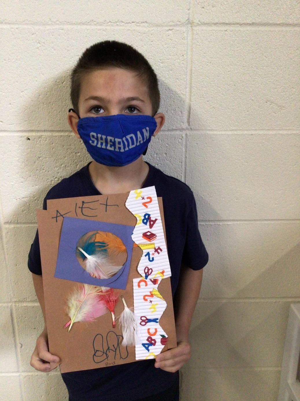 A student displays his bird nest