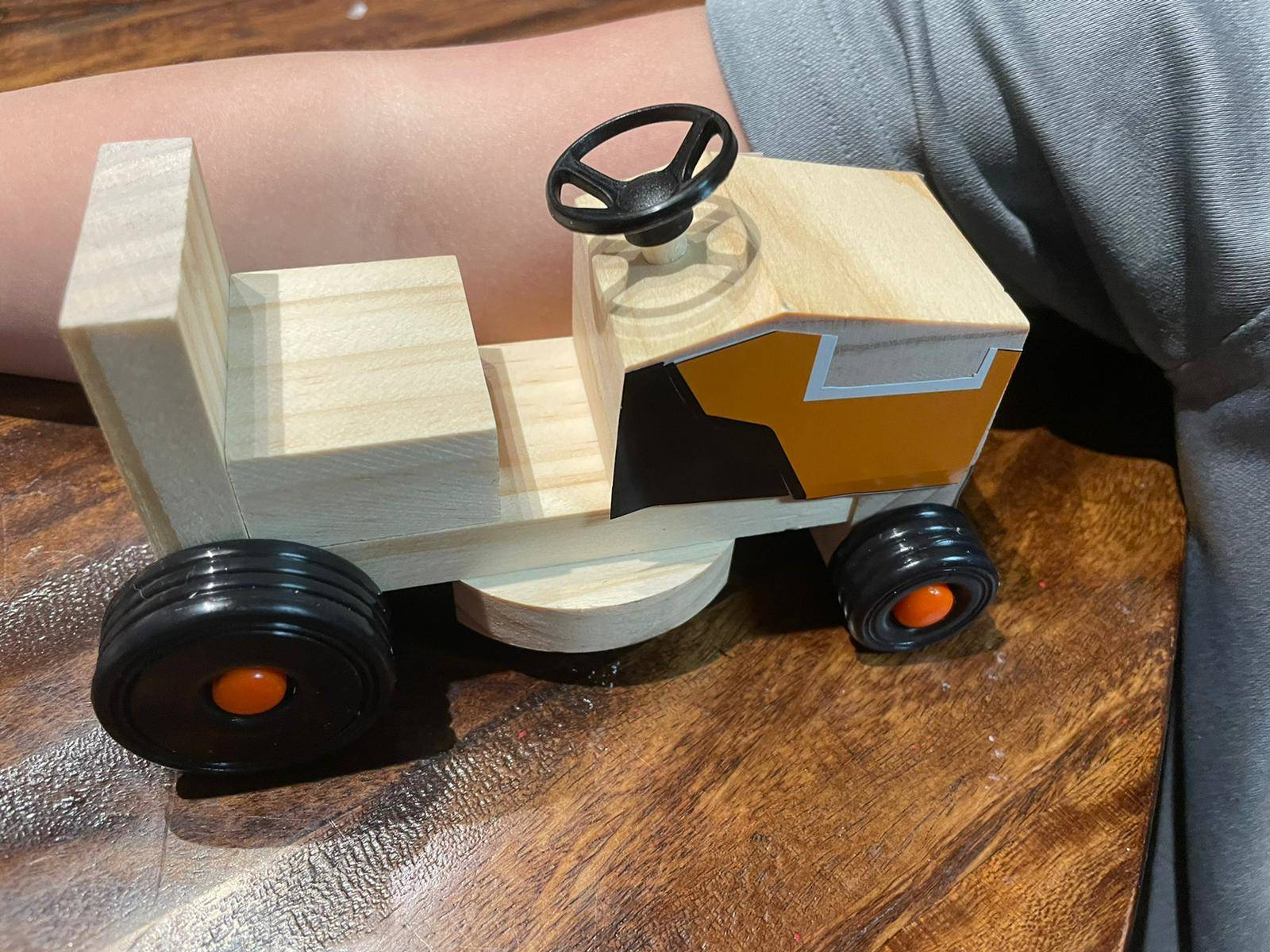 A student displays their tractor made from their Home Depot Kit.