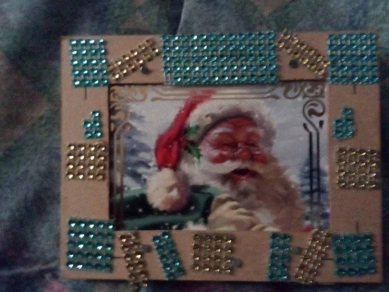 A picture frame that was created at home with a Home Depot kit. Santa Claus is within the frame.