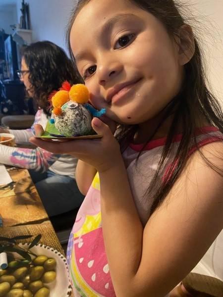 A little girl displays her pet rock