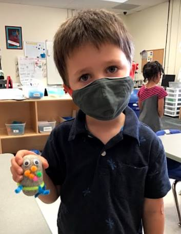 A student holds his pet rock.