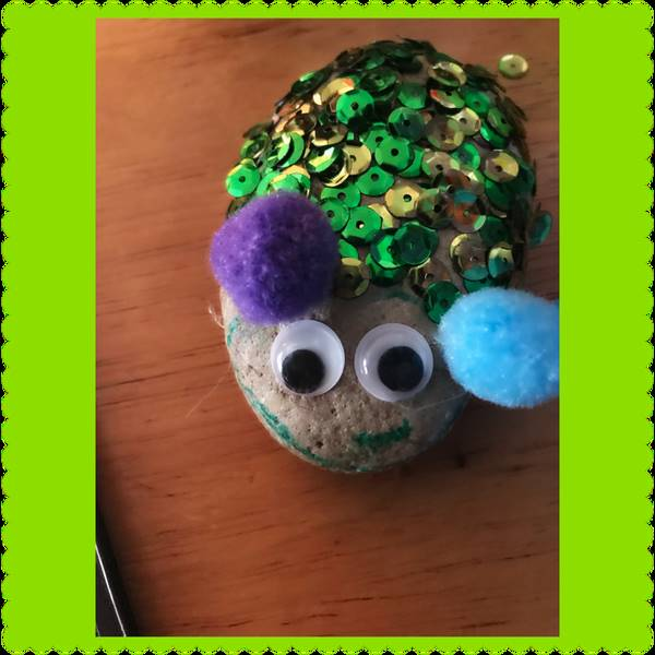 """A pet rock - a """"hamster"""" displayed with many sequins."""