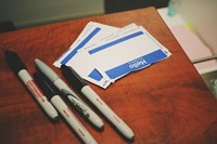 Name Tags on a desk with some pens